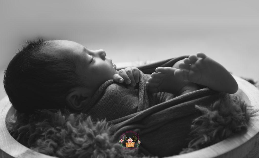 newborn baby in a bowl