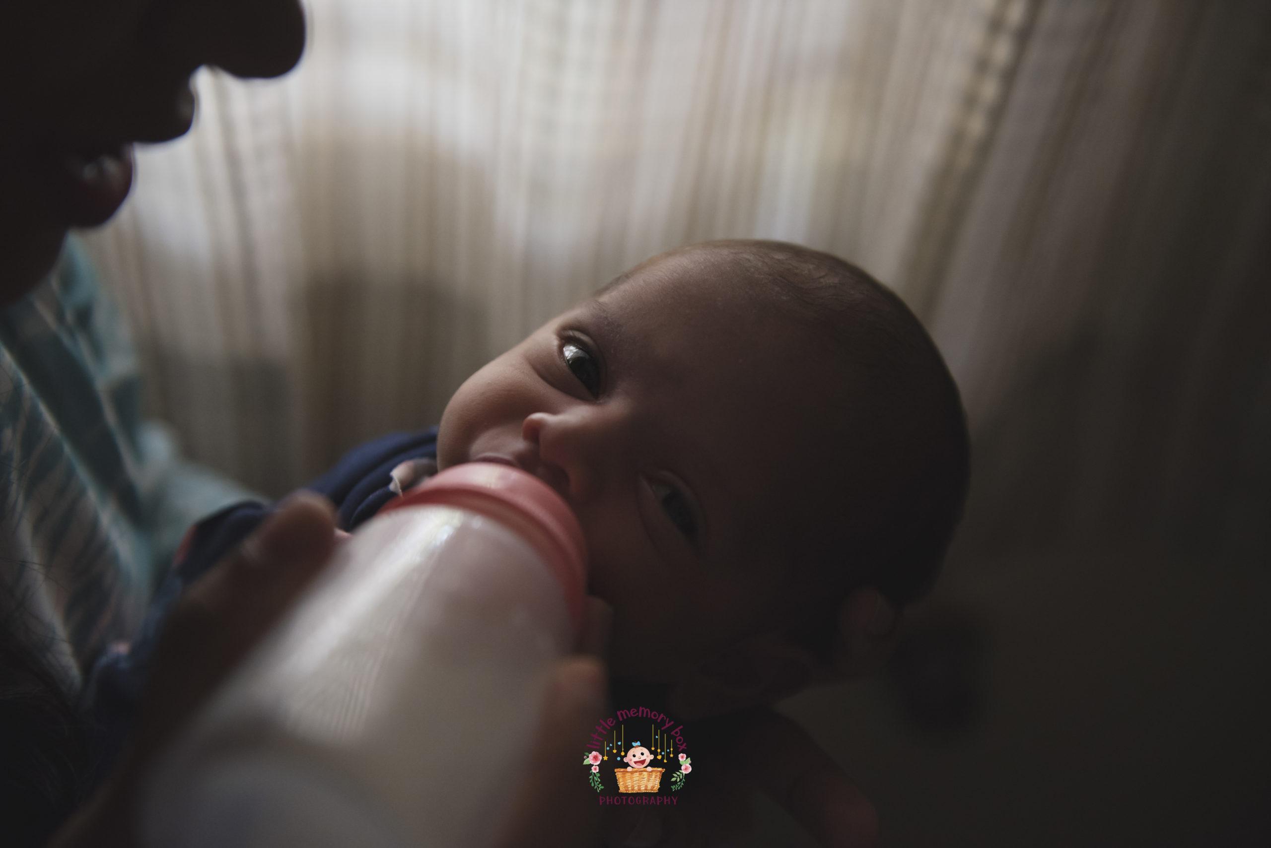 mom feeding baby milk