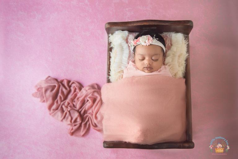 newborn baby girl in prop