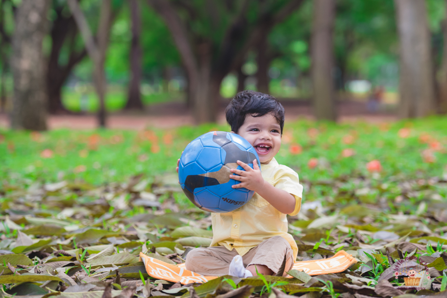 kid playing with football