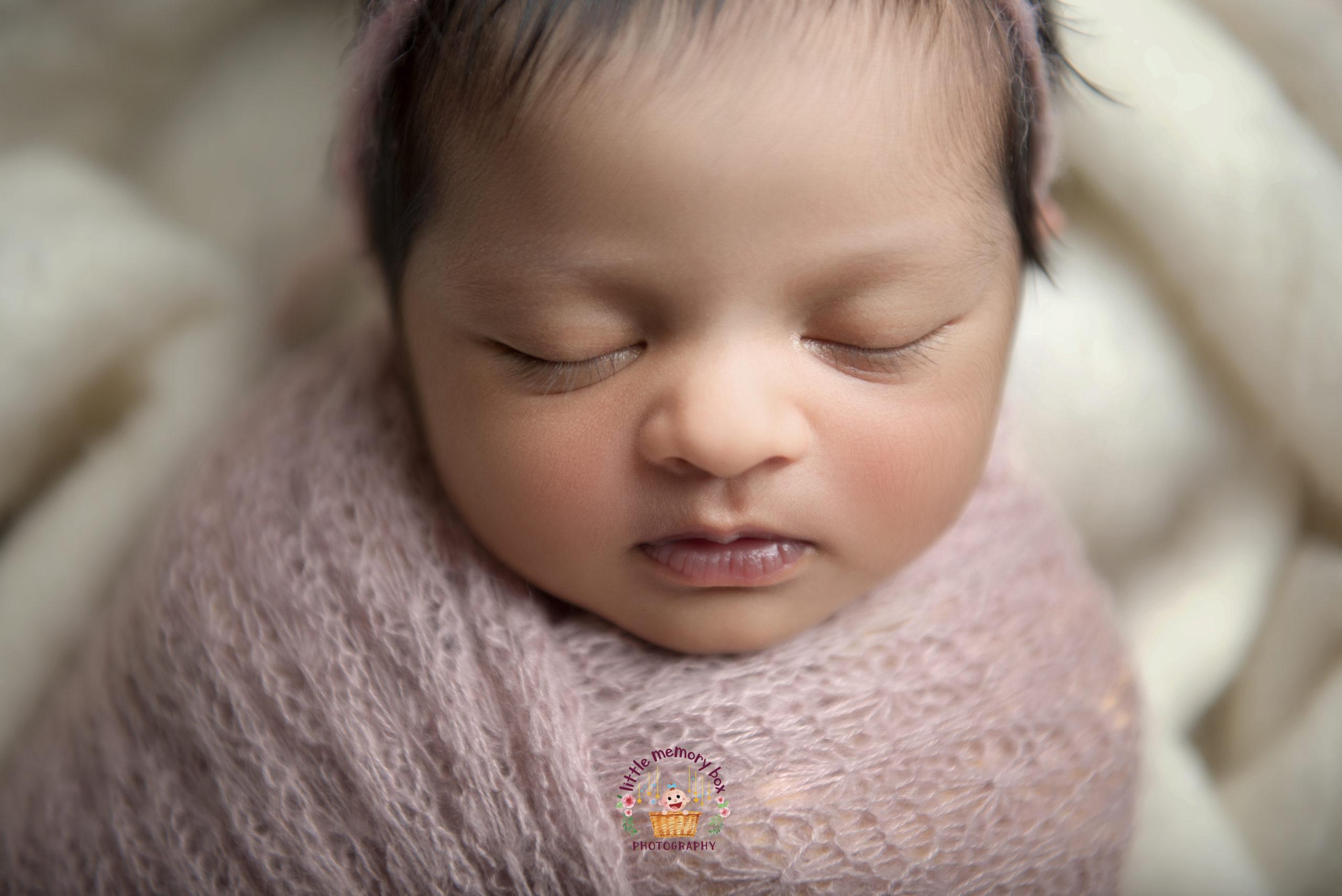 closeup of newborn baby face